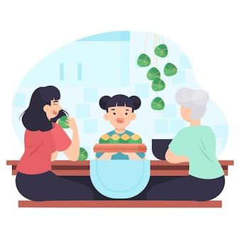 Familie zongzi eten