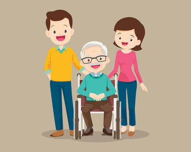 Familie zorgt voor grootvader zittend op een rolstoel