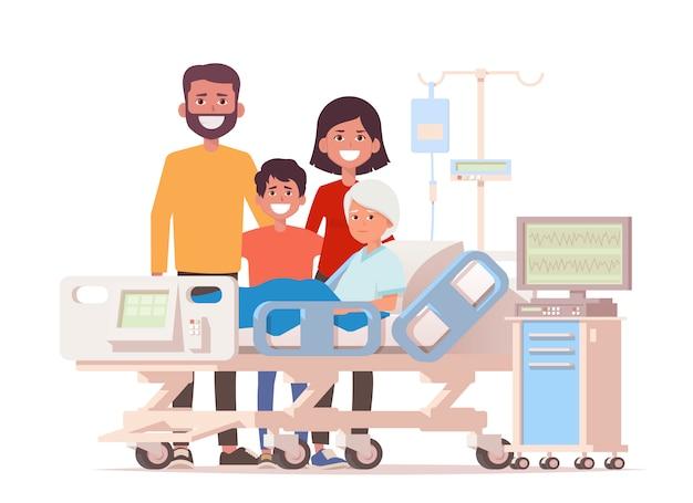 Familiebezoek bij ziekenhuis zieke oma liggend in een medisch bed