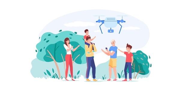 Familiekarakters die plezier hebben, spelen met drone in het park buiten