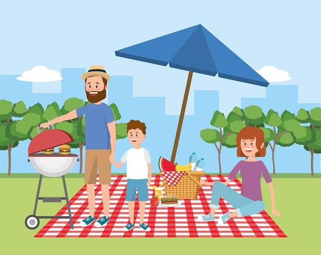 Familiepicknick met paraplu en mand met fruit