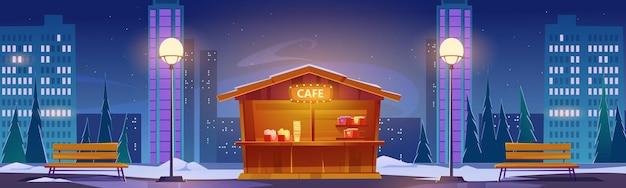 Fast-food straatcafé bij stadsgezicht van de winternacht