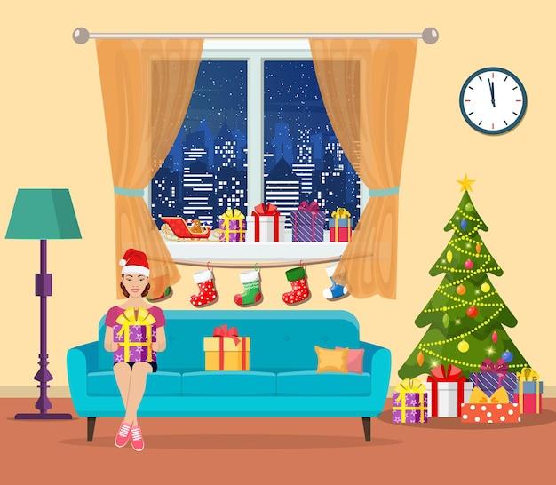 Feestelijk meisje dat een cadeau opent