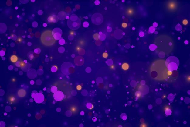 Feestelijke paarse en gouden lichtgevende achtergrond met kleurrijke lichten bokeh. kerst concept xmas wenskaart. magische vakantieaffiche, spandoek. nacht helder goud schittert licht abstract