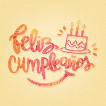 Feliz cumpleaños belettering met cake en kaarsen