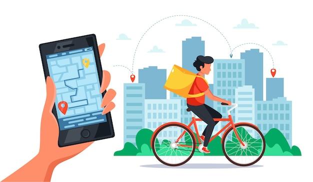 Fiets levering dienstverleningsconcept. koerier op de fiets met bezorgdoos, hand met smartphone met online tracking. in vlakke stijl.