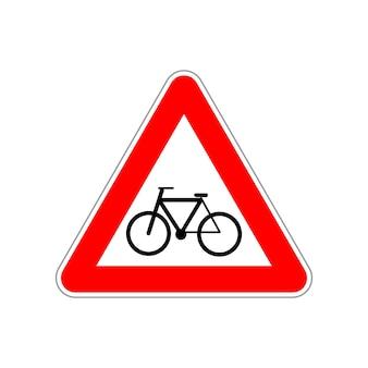Fietspictogram op het driehoekige rode en witte verkeersbord dat op wit wordt geïsoleerd