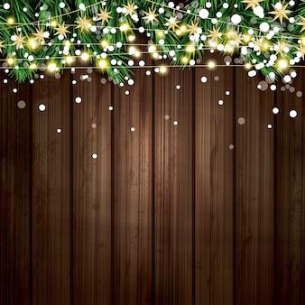 Fir branch met neonlichten en sneeuwvlokken