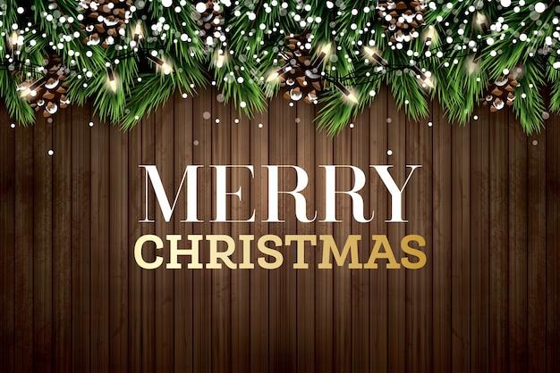 Fir tak met neonlichten en dennenappel op houten achtergrond. vrolijk kerstfeest. gelukkig nieuwjaar.