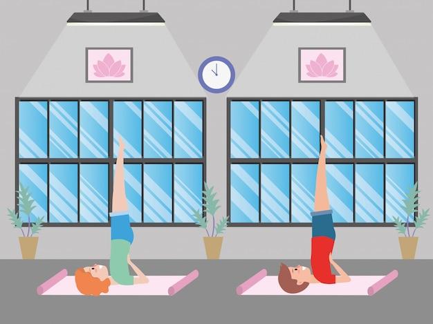 Fit paar beoefenen van yoga