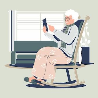 Flat-hand getekend senior met behulp van technologie