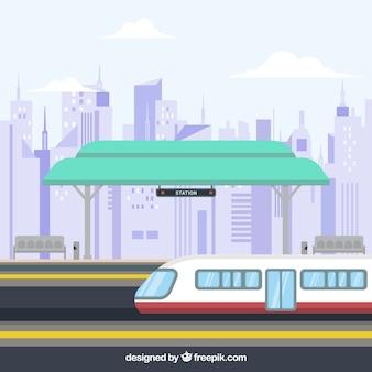 Flat treinstation met gebouwen achtergrond