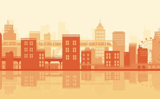 Flatgebouwen door de rivier in oranje vlakte
