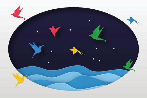 Flock of origami birds flying