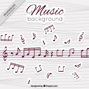 Fondo de pentagramas y notas musicales de colores