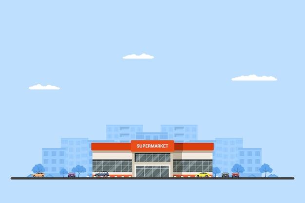 Foto van een supermarktgebouw met auto's en grote stad sillhouette op achtergrond. stedelijk landschap. .