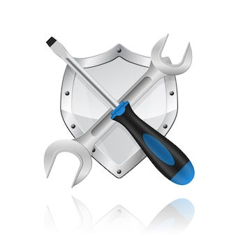 Foto van gekruiste moersleutel en schroevendraaier op witte achtergrond
