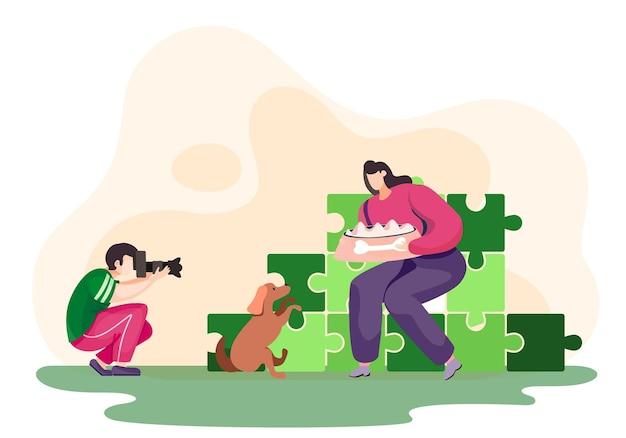Fotograaf maakt foto van de jonge vrouw en haar hond in het park met puzzels op de achtergrond