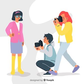 Fotografen werken met platte ontwerppersonages