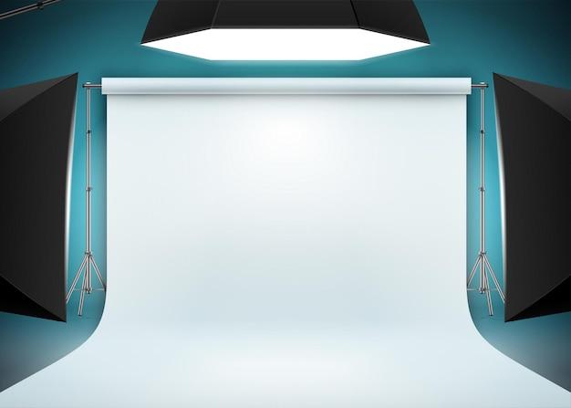 Fotostudioscène met wit achtergrondpapier en felle studiolampen