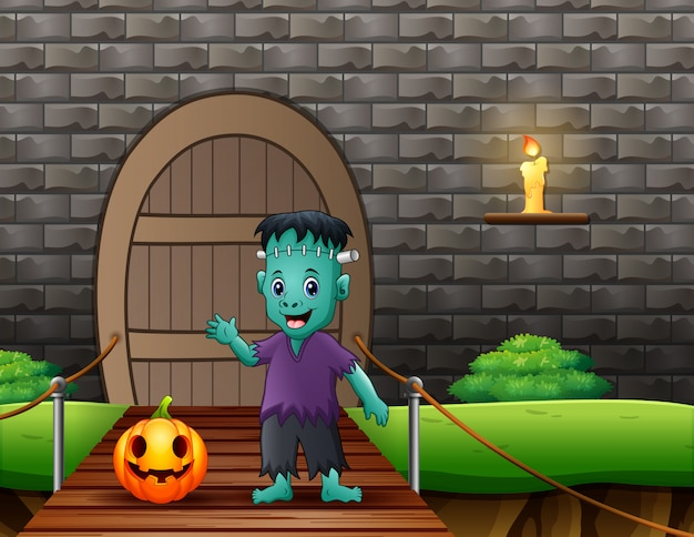 Frankenstein cartoon met een pompoen op hangbrug