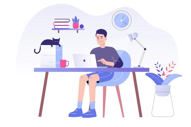 Freelancer man zittend op een bureau en online werken met een laptop thuis