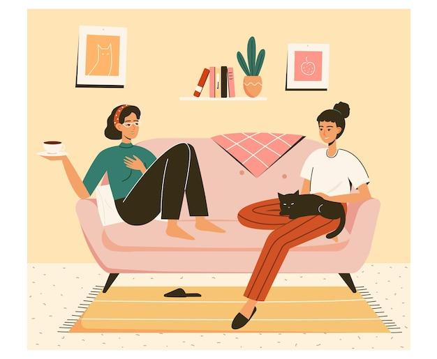 Frindship-concept twee vriendinnen praten thuis op de bank