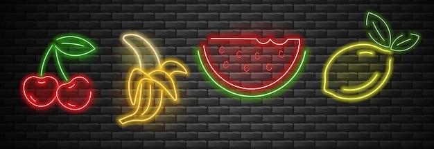 Fruit set neonlicht, kers, banaan, watermeloen en citroen neon, zomer set, bakstenen achtergrond