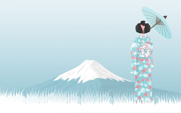 Fujiberg met japanse vrouw die in kimono-kleding de mening bekijkt.