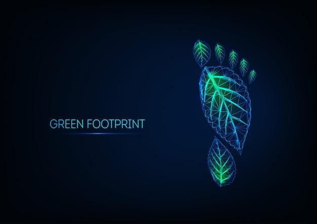Futuristische gloeiende laag poly menselijke voetafdruk gemaakt van groene bladeren geïsoleerd op donkerblauw