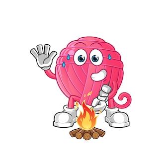 Garenbal die marshmallows-karakter roostert. cartoon mascotte