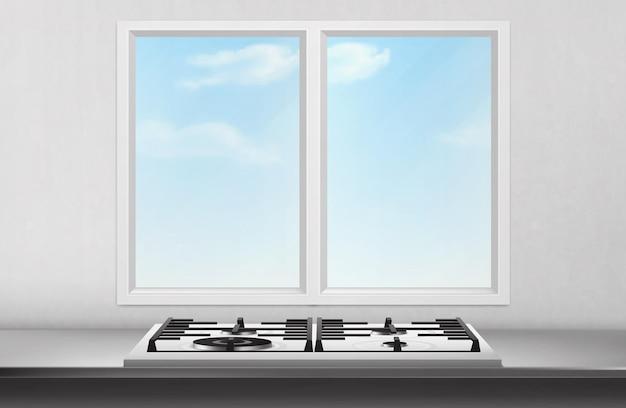 Gas- en elektrisch fornuis op tafel oppervlak voorkant van keukenraam en blauwe lucht uitzicht op witte muur.