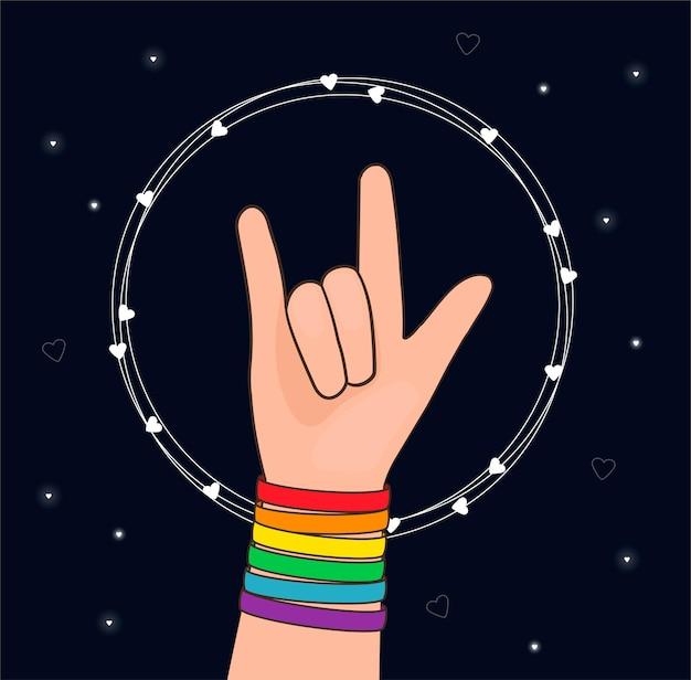 Gebaar van liefde met kleurrijke lgbtq-polsband op een hand concept van lgbt-trots concept