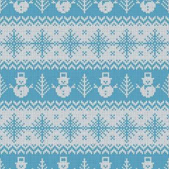 Gebreid naadloos patroon met sneeuwmannen en sneeuwvlokken.