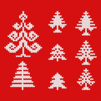 Gebreide iconen van kerstbomen voor het tekenen van wenskaarten en reclame voor kerstmis en nieuwjaar.