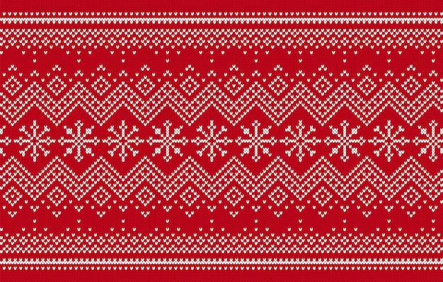 Gebreide print. kerst naadloze patroon. rode gebreide trui achtergrond. textuur met zigzag en sneeuwvlokken
