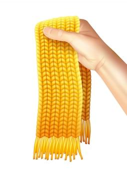 Gebreide sjaal in de hand realistische illustratie