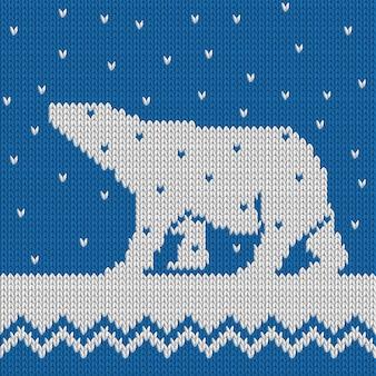Gebreide winter blauwe naadloze patroon met ijsbeer met sneeuw