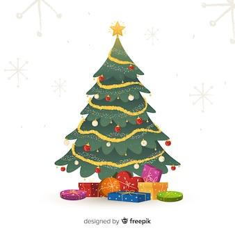 Gedecoreerde kerstboom met geschenken