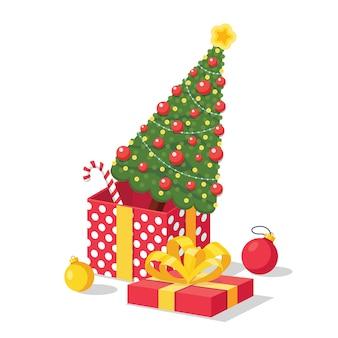Gedecoreerde kerstboom met ster, lichtjes, decoratieballen in geschenkverpakking. vrolijk kerstfeest en een gelukkig nieuwjaar