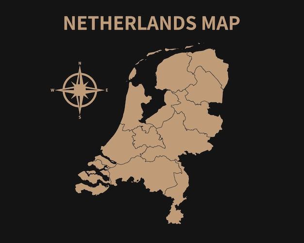 Gedetailleerde oude vintage kaart van nederland met kompas en regiogrens geïsoleerd op donkere achtergrond