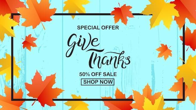 Geef dank verkoop banner hand getrokken belettering met elementen van de herfstbladeren
