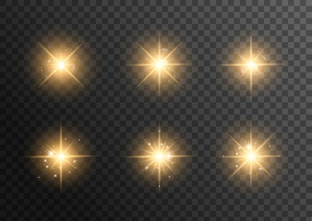 Geel gloeiend licht explodeert op transparant. sprankelende magische stofdeeltjes. heldere ster. transparante stralende zon, heldere flits.