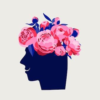 Geestelijk gezondheidsconcept abstract beeld van hoofd met bloemen erin