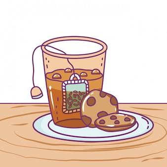 Geïsoleerd theeglas en koekje