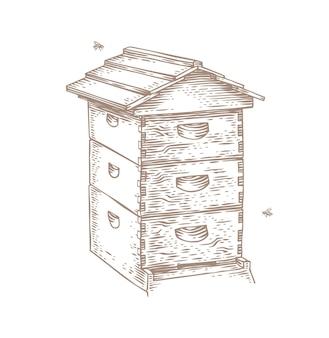 Geïsoleerde houten bijenkorf en twee bijen