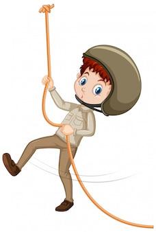 Geïsoleerde jongen in het bruine eenvormige beklimmen