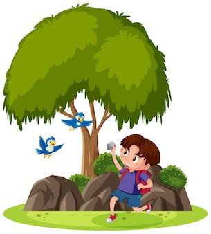 Geïsoleerde scène met een jongen die steen naar vogels probeert te gooien
