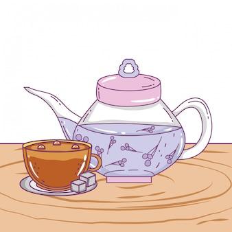 Geïsoleerde theepot en koffiekopje