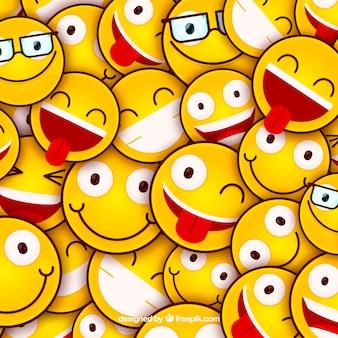 Gekleurde achtergrond met emoticons in plat ontwerp